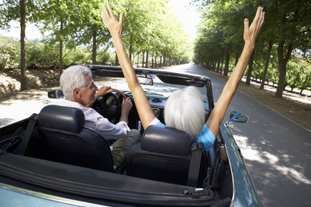 retired: Senior couple in sports car