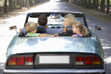 family in sports car photo