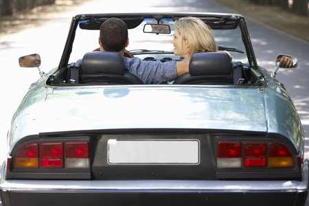 countryside loving: Couple in sports car