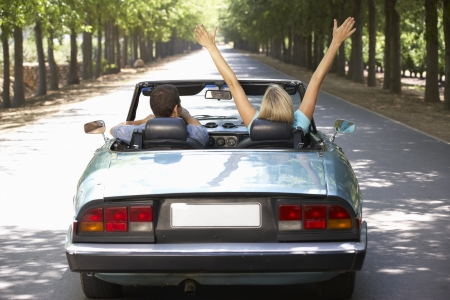 Couple in sports car photo