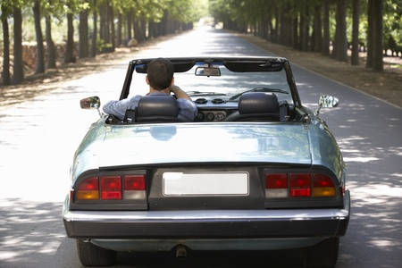 open country: Man in sports car