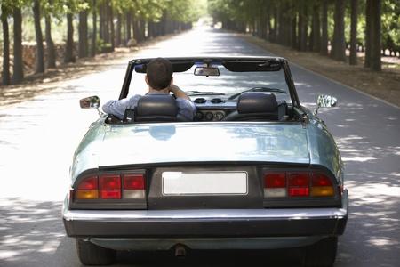 top down car: Man in sports car