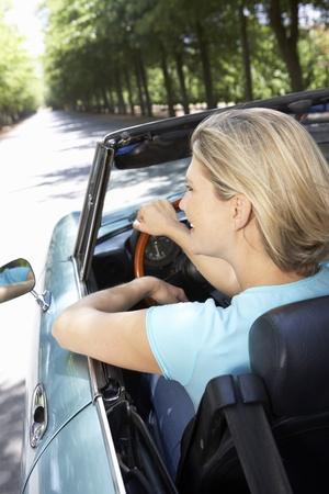 top down car: Woman in sports car