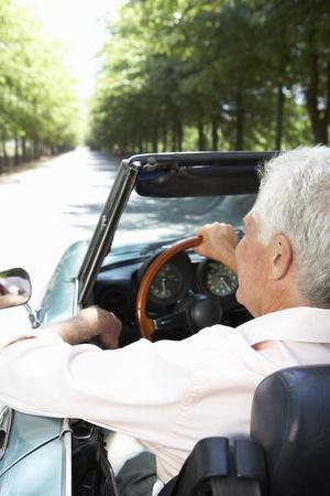 top down car: Senior man in sports car Stock Photo