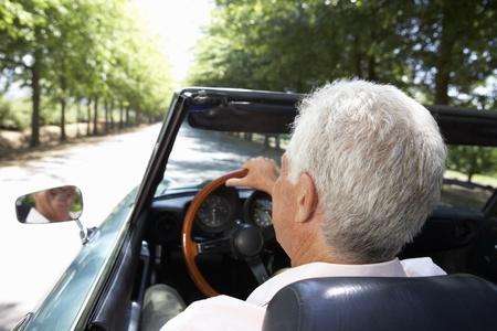Senior man in sports car Stock Photo