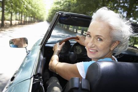 convertible: Senior woman in sports car
