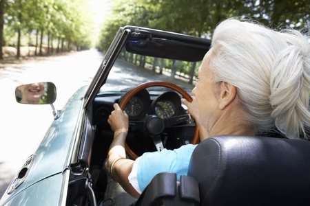 Senior woman in sports car photo