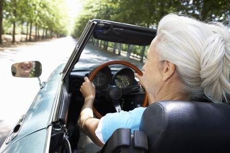 top down car: Senior woman in sports car