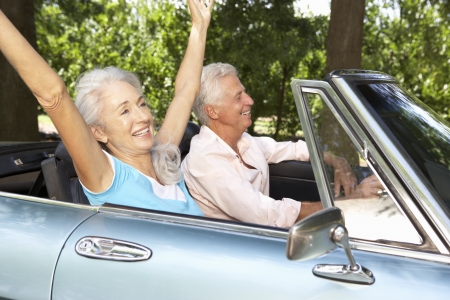 Senior couple in sports car photo