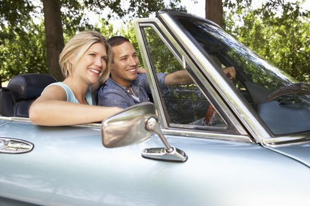 top down car: Couple in sports car