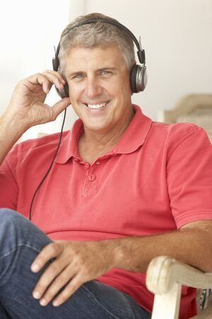 Mid age man wearing headphones photo