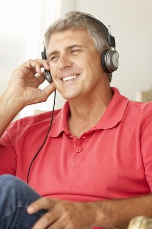 Mid age man wearing headphones Stock Photo - 11190589