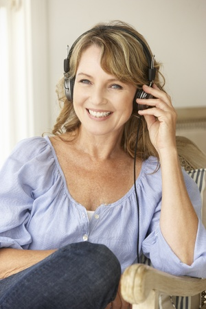 Mid age woman wearing headphones photo
