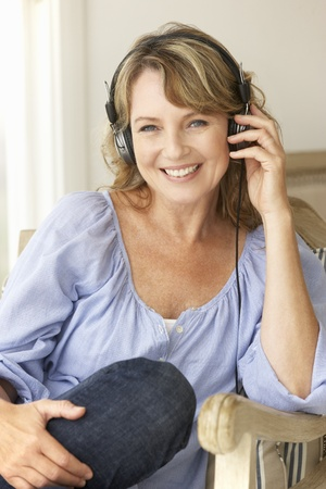 Mid age woman wearing headphones Stock Photo - 11190892
