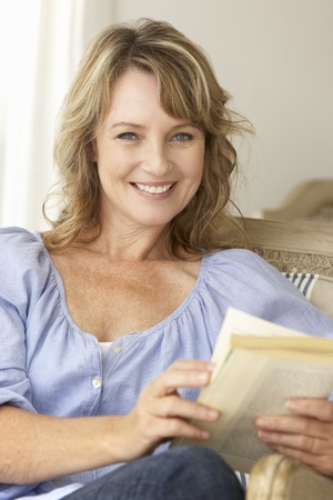 Mid age woman reading a book photo