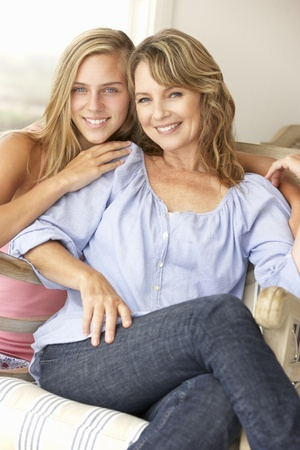 40s adult: Mid age woman and teenage daughter at home Stock Photo