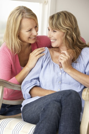 Adult mother and daughter at home photo