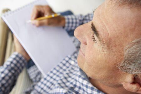 greying: Mid age man sketching