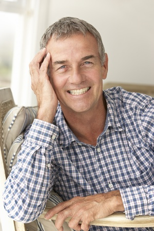 greying: Mid age man at home