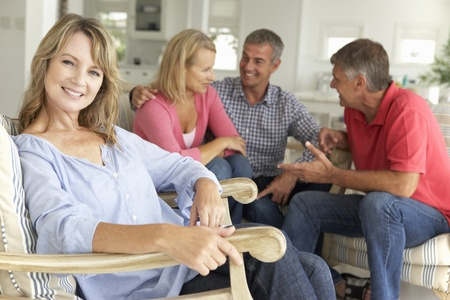 greying: Mid age couples relaxing at home