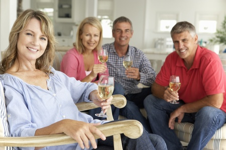 drink responsibly: Mid age couples drinking together at home