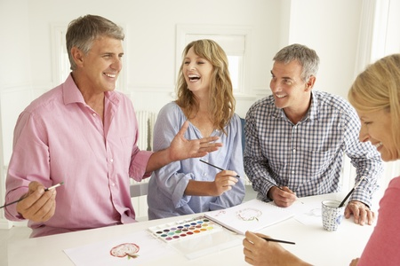 artist painting: Mid age couples painting with watercolors Stock Photo