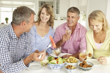 Mid age couples enjoying meal at home Stock Photo - 11190573