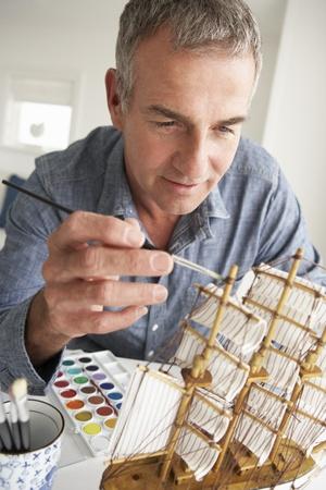 greying: Mid age man model making