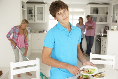complaining: Teenagers reluctantly doing housework