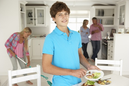 Teenagers helping with housework