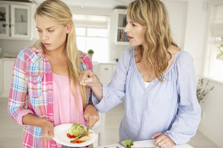 reluctant: Mother and teenage daughter arguing about housework