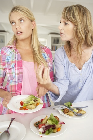 Mother arguing with teenage daughter photo