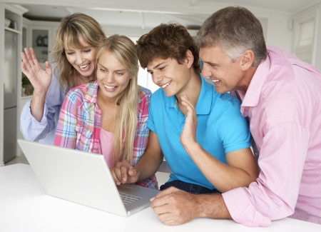 Family using laptop photo