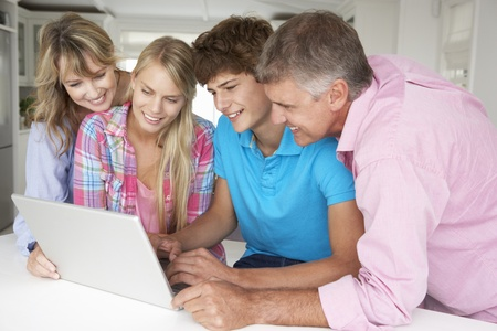 Family using laptop photo