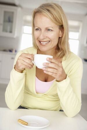 40s adult: Mid age woman with coffee at home Stock Photo