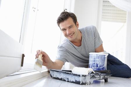refurbishing: Man decorating house