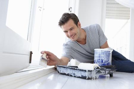 redecorating: Man decorating house