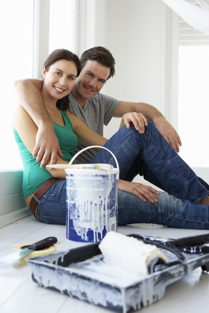 first home: Couple decorating house Stock Photo
