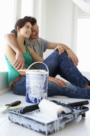 house renovation: Couple decorating house Stock Photo