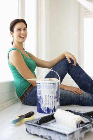 refurbishing: Woman decorating house Stock Photo