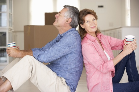moving box: Senior couple in new home