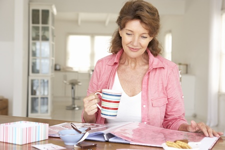 Senior woman scrapbooking photo