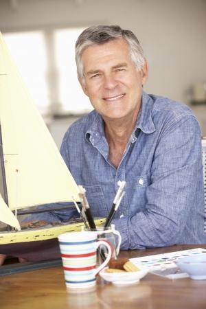 older: Senior man model making