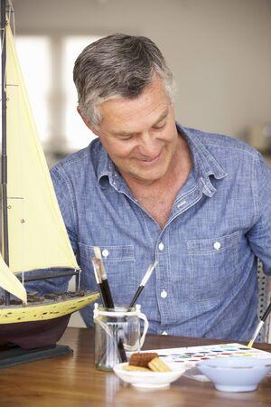 greying: Senior man model making