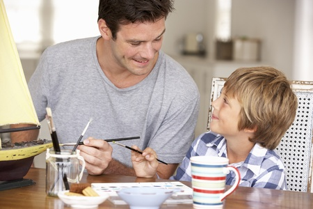 father and child: Father model making with son Stock Photo