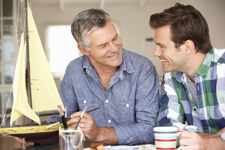 older person: Adult father and son model making Stock Photo