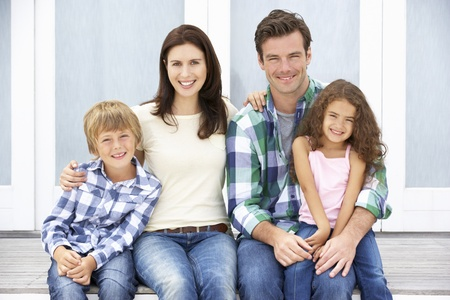 women in jeans: Portrait family outdoors Stock Photo
