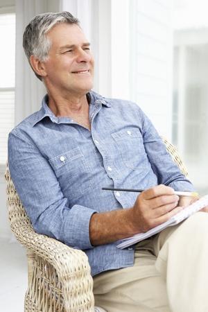 Senior man sketching photo