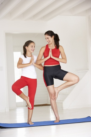 mother daughter: Mother and daughter doing yoga