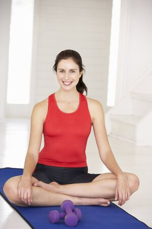 Woman sitting in lotus position photo